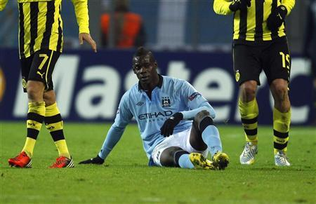 Manchester City's Balotelli sits on the field during their Champions League group D soccer match against Borussia Dortmund in Dortmund. AP