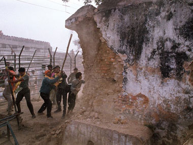 Hindu kar sevaks tearing down the walls of the Babri Masjid in 1992. AFP