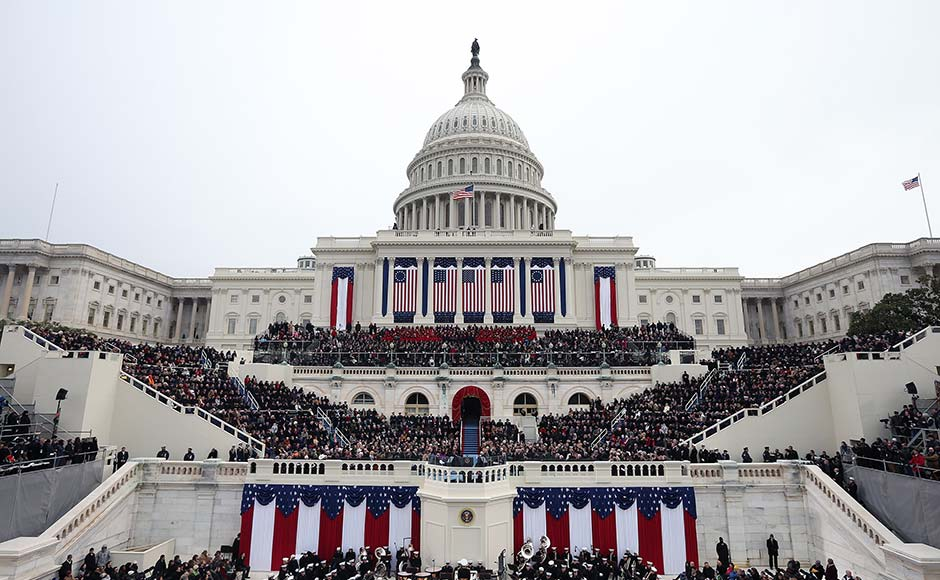 People attend the presidential inauguration on the West Front of the US Capitol. Justin Sullivan/Getty Images