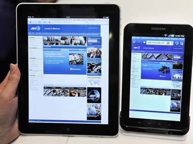 An Apple iPad and a Samsung Galaxy tab. AFP