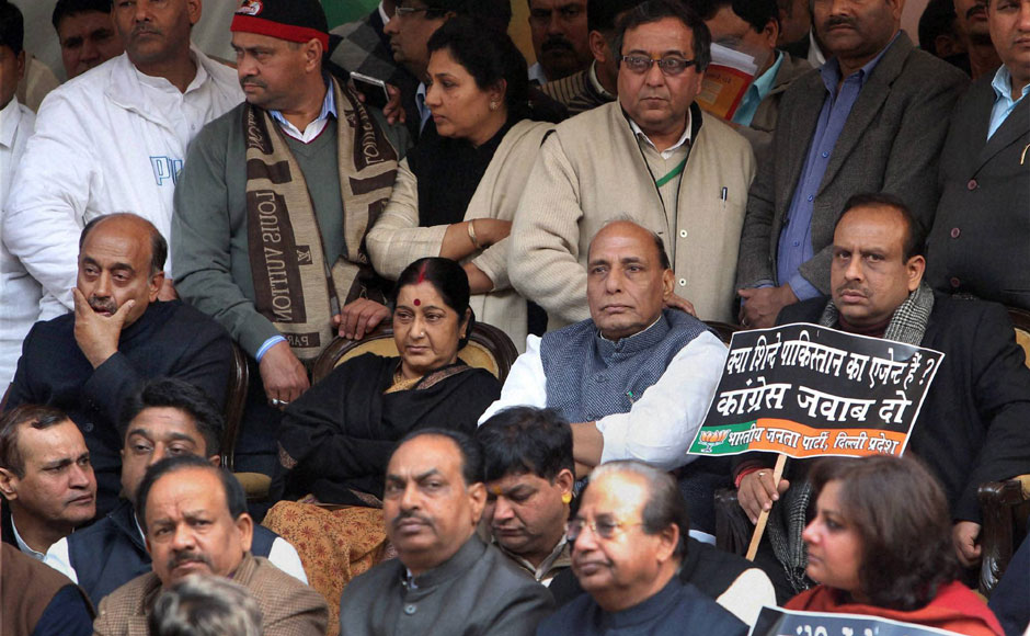 BJP leaders Sushma Swaraj and Rajnath Singh at the venue of the protest against Sushil Kumar Shinde. PTI