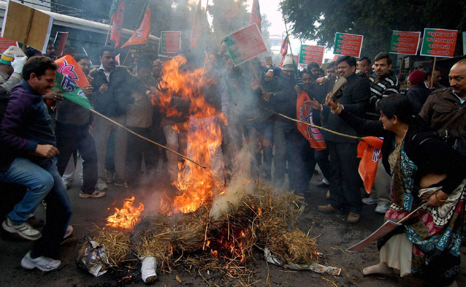 BJP workers burn effigy of Union Home Minister Sushil Kumar Shinde during a protest over his controversial Hindu terror remarks in Lucknow on Thursday. PTI