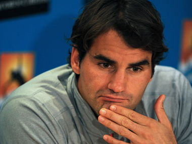 Switzerland's Roger Federer listens to a journalist's question during a press conference after defeat in his men's singles semi-final against Britain's Andy Murray on day twelve of the Australian Open tennis tournament in Melbourne on January 25, 2013. Getty Images