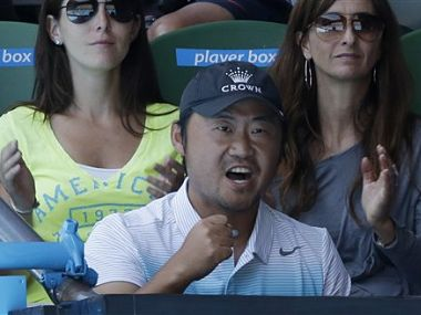 Jiang Shan, husband of China's Li Na cheers her on during her quarterfinal match against Poland's Agnieszka Radwanska. AP