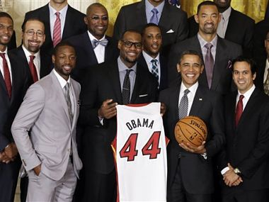 President Barack Obama poses with the Miami Heat. AP
