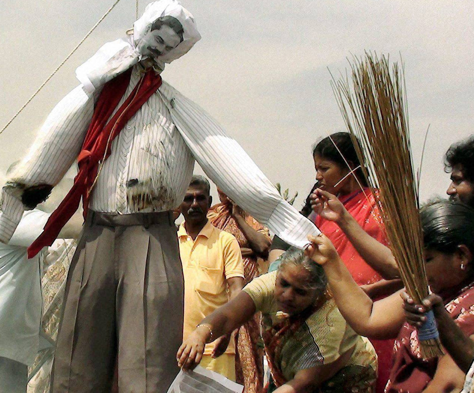 People hang an effigy of Sri Lankan President Mahinda Rajapaksa during a protest against his visit to India, in Idinthakarai. PTI
