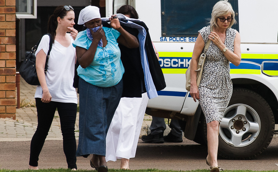 Sister of Olympic athlete Pistorius, Aimee, left, leaves the Mamelodi Hospital, South Africa, where she visited her brother while he was being examined. AP