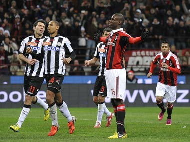 Balotelli celebrates after scoring his first goal for AC Milan. Reuters