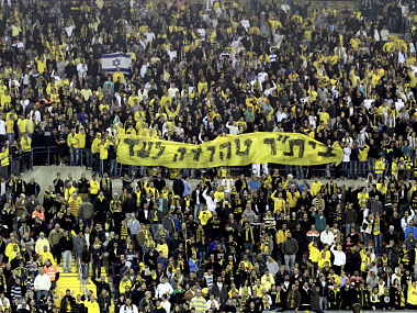 """Supporters of Beitar Jerusalem soccer club hold a banner reading """"Beitar will always remain pure"""". Reuters"""