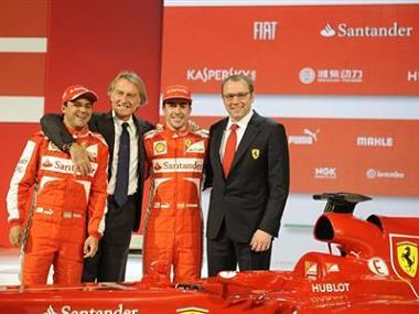 Ferrari boss di Montezemolo poses with Ferrari Formula One drivers during launch of new Ferrari F138 car.  Reuters