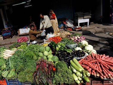 In this photograph taken on February 16, 2011, an Indian vendor sells vegetables on a street in New Delhi. Reuters