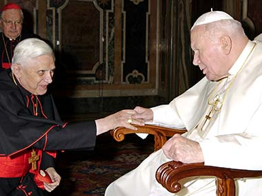 In this file photo taken Dec. 22, 2003 provided by the Vatican's L'Osservatore Romano daily, late Pope John Paul II, right, greets then Cardinal Joseph Ratzinger, Prefect of the Catholic Church's Congregation for the Doctrine of the Faith. AP