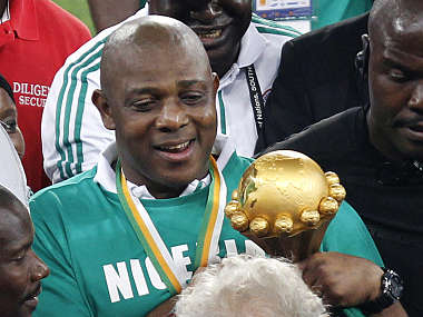 Nigeria's coach Stephen Keshi reacts as he holds the trophy after their African Nations Cup final. Reuters