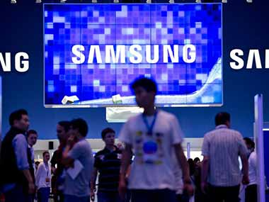 Samsung's logo is seen in this background. AFP