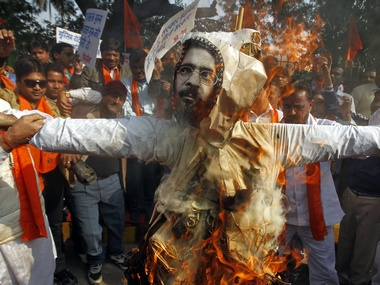 Right wing activists burn an effigy of Afzal Guru. Reuters.