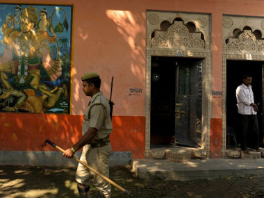A policeman walks past a temple in Ayodhya. AFP