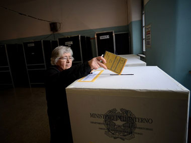 A woman casts her vote at a polling station in Rome. AFP