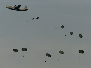 Indian Air Force paratroopers jump from C-130J aircraft during the Iron Fist 2013 in Pokhran. AFP