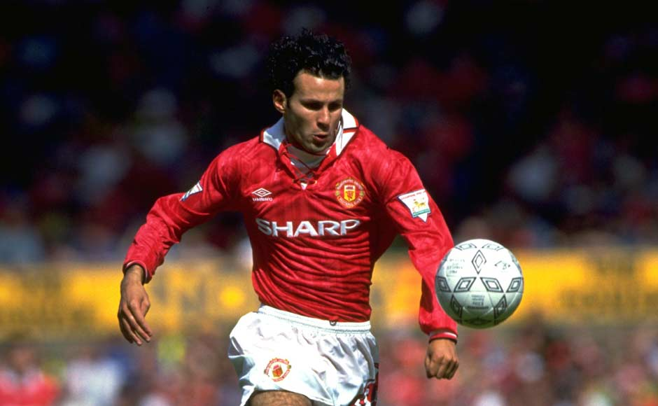 Breaking into the team in 1991, Ryan Giggs was quick to establish himself as a regular. Here he is in 1993, curly hair and unlimited energy on the left wing. Getty Images