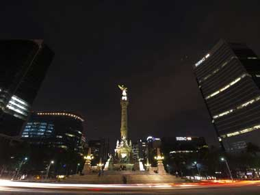 The Angel de la Independencia monument is pictured moments before switching off its lights during Earth Hour in 2012. The world wide event to promote conservation of resources. AFP