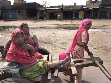 File image of women in front of houses burnt in Naroda riot. AFP