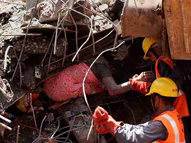 Rescue work is carried out at the site of the collapsed building in Thane, Mumbai. PTI