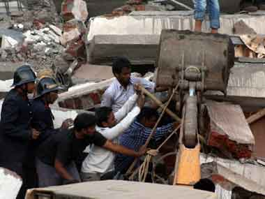 Civilians and fire brigade personnel carry out rescue operation at the building collapse site bat Mumbra in Thane on Thursday. PTI