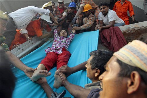 Rescuers lower down a survivor from the debris of a building that collapsed in Savar, near Dhaka, Bangladesh. AP