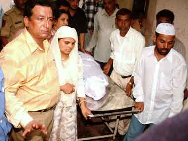 Relative carrying Ishrat Jahan's body. AFP