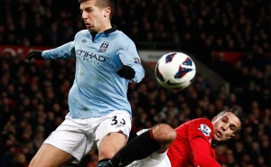 Manchester United's Robin van Persie, right, is challenged by Manchester City's Matija Nastasic. AP