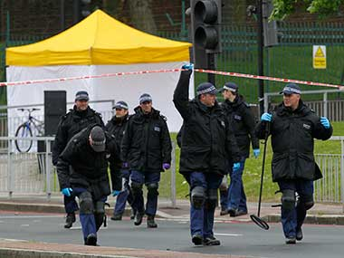 olice search team leave the scene of a terror attack in Woolwich, southeast London. AP