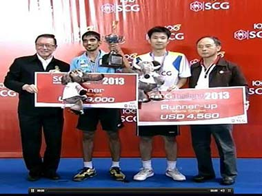 Srikanth (in blue)  with the winning trophy.
