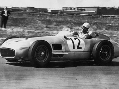 Stirling Moss drives home to victory at Aintree in 1955. Getty Images