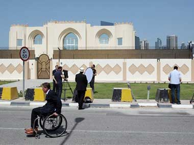The Taliban office was forced to take down its sign and flag. AP