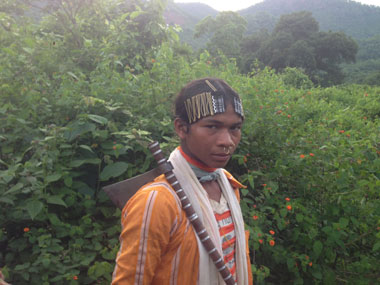 A dongria Kondh youth stands guard on the road to Serkapadhi. Image: Jay Mazoomdar