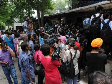 The media gathered outside the Juvenile Justice Board during the hearing on the juvenile accused. AFP