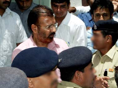 D G Vanzara (C) and Rajkumar Pandiyan (L), two of the three senior officers arrested in the Soharabuddin Sheikh fake encounter: AFP