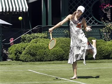 Newly inducted Tennis Hall of Famer Martina Hingis, of Switzerland, hits a tennis ball in the style of French tennis legend Suzanne Lenglen. AP