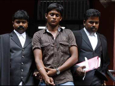 Ilavarasan coming out of the Madras High Court after a court hearing. After getting married against his wife's family's wishes, he filed a missing complaint after she left his home. Firstpost