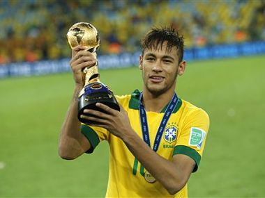 Brazil's Neymar holds the trophy after winning the soccer Confederations Cup final between Brazil and Spain. AP