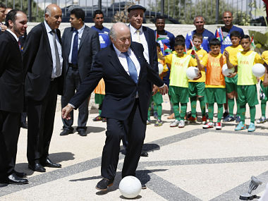FIFA President Sepp Blatter (C) kicks a ball during the inauguration ceremony of a football academy named after him in Al-Bireh, near the West Bank city of Ramallah. Reuters