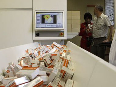A file photo of a newly mechanized pharmaceutical machine that helps pharmacists dispense medicine is loaded with ARV medication. AP