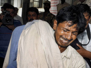 A man mourns as he holds his dead daughter in Patna Medical College and Hospital. PTI