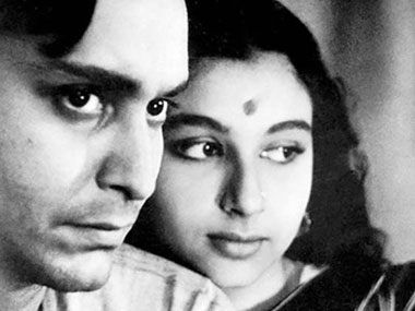 Soumitra Chatterjee with Sharmila Tagore in Apur Sansar. IBN Live.