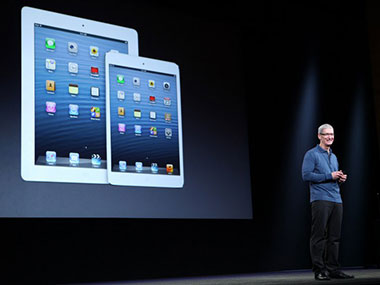Apple CEO Tim Cook at the launch of the iPad 4th generation and iPad mini. AFP