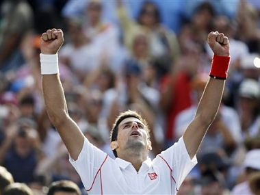Novak Djokovic, of Serbia, reacts after beating Stanislas Wawrinka, of Switzerland. AP
