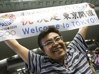A Japanese man celebrates after hearing that Tokyo was chosen to host the 2020 Olympic Games during a public viewing event in Tokyo. Reuters