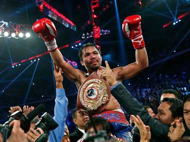 Pacquiao's boxing record 59-7 (30 by KO). AP