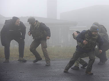 OPCW inspectors run for cover after an explosion during hostile environment training scenario in Wildflecken. Reuters