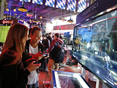 PlayStation fans go hands on at the PlayStation 4 launch event. AP